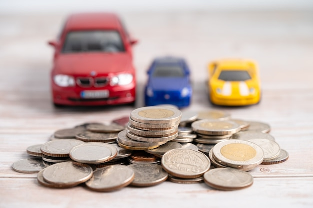 Car on coins background car loan finance saving money insurance and leasing