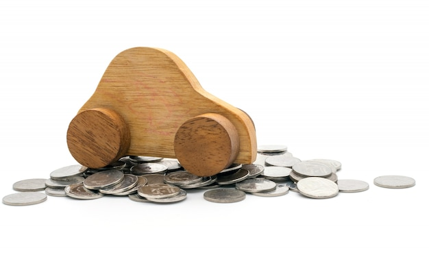 Car and coins on white background