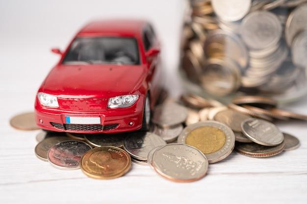 Car on coins  .