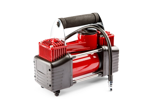 Car compressor isolated on white background. electric pump inflates a car wheel