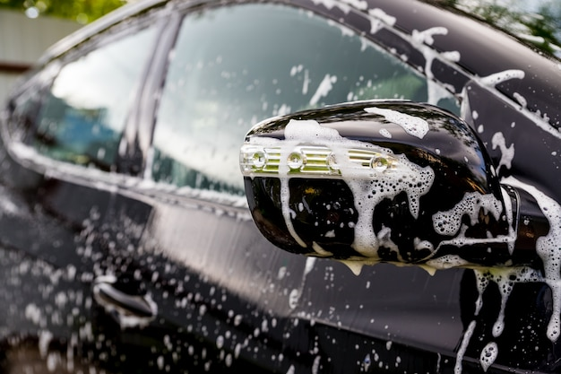 Car covered by soap and water.