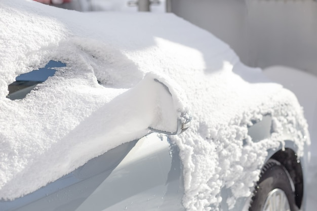 Car covered in snow.