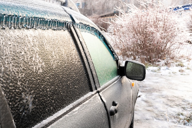 Car covered with ice crust after icy rain