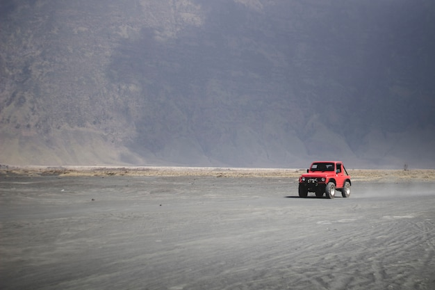 The car crosses the desert in bromo tengger semeru national park