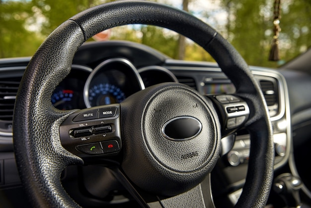 Car dashboard and steering wheel, modern car interior design