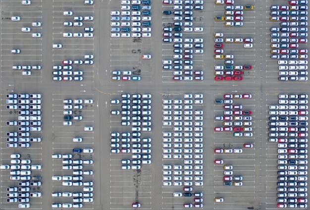 Car dealer logistics center, new cars parked.