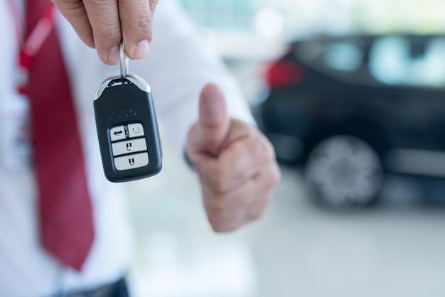 Car dealer with a key
