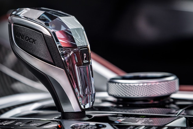 Car detailing.chrome automatic transmission lever shift. accelerator handle and  parking buttons