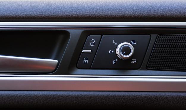 Car door lock button closeup