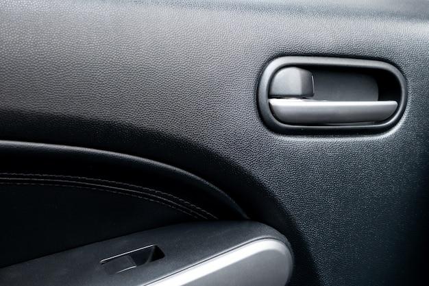 Car door lock lever inside driver place.