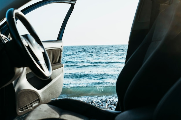 Car door open near sea
