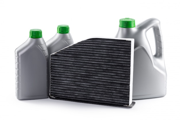 Car filters and motor oil can isolated on white