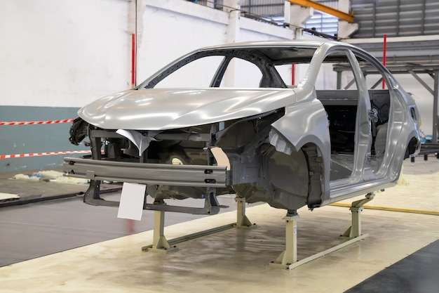 Car frame with unfinished assembly in the tester line of the automobile factory