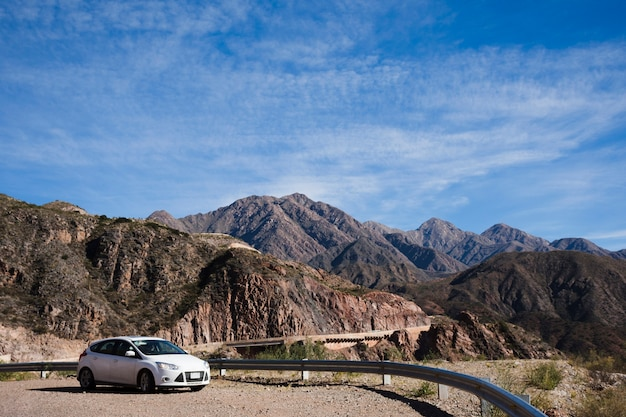 Car in front of mountain landscape