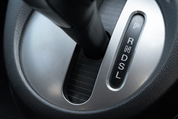 Car gearbox lever in driver place.