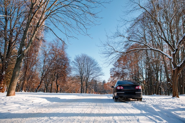 The car goes on the road in winter