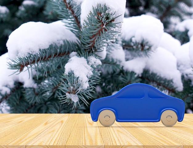 Значок автомобиля среди заснеженных ветвей елки