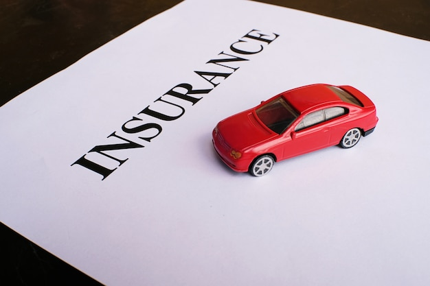 Car insurance concept with policy.