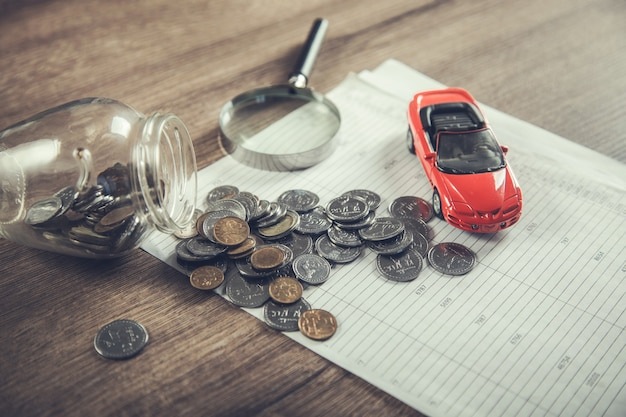 Car insurance with coins on the document