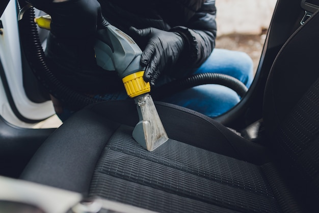 Car interior textile seats chemical cleaning with professionally extraction method. early spring cleaning or regular clean up.