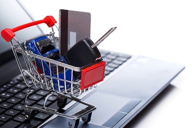 Car and key in shopping trolley
