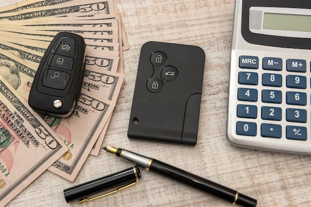 Car key with remote control and us money. sale