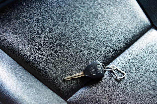 Car keys on leather seats. people forget the car keys in the car.