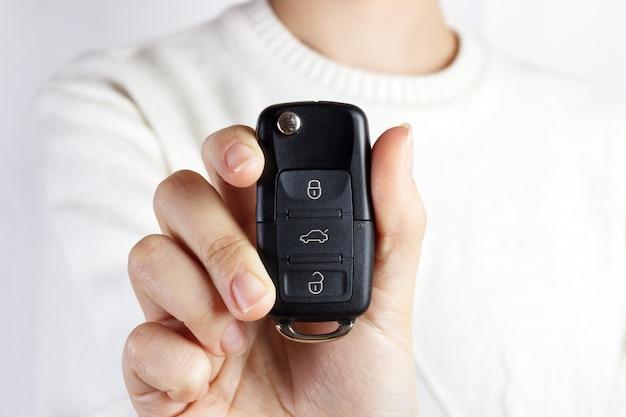 Car keys. seller hand giving keys. girl with car keys