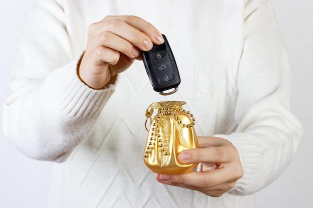 Car keys. seller hand giving keys.