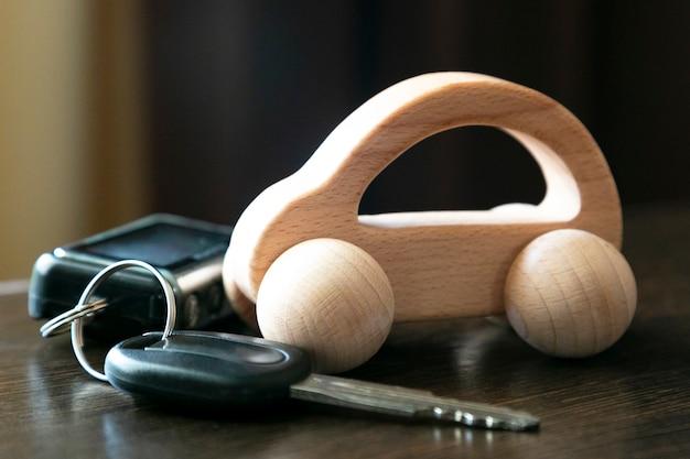 Car keys and a wooden car.