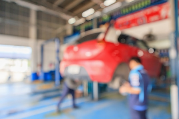Car lift at maintenance station blur background