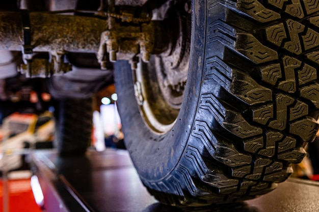 Car lifted in automobile service for fixing