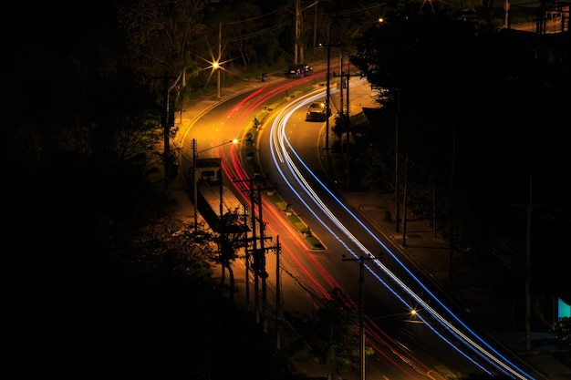 Car light trails in the road. art image . long exposure photo taken in a road