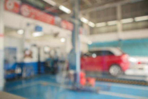 Car maintenance in service center blur background
