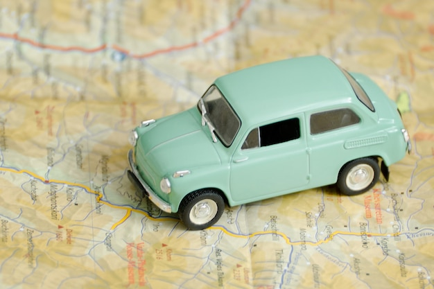 Car on the map. travel concept. close up