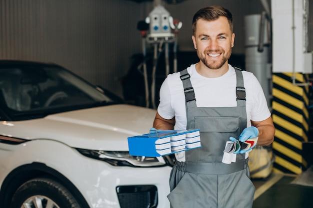 Car mechanic choosing color for car
