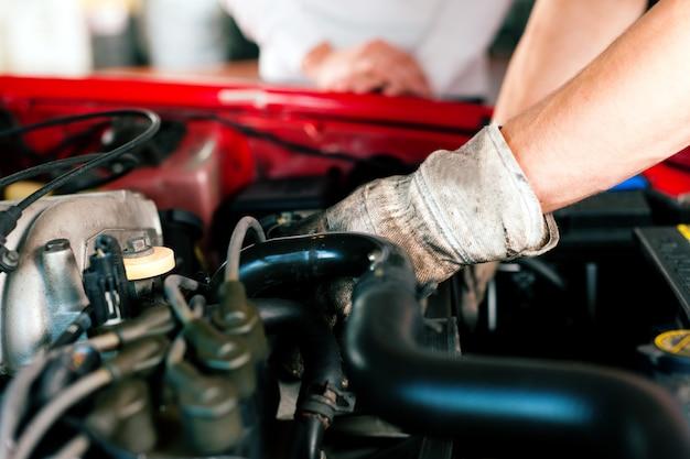 Car mechanic in repair shop