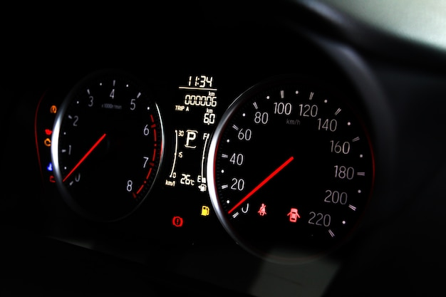 Car miles or speedometer scoring with icon and number of car on dashboard