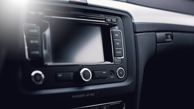 Car navigation system in modern car interior.