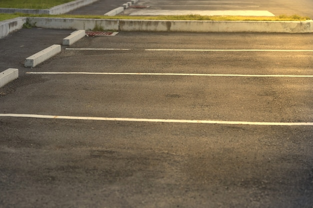 Car park lots area with lot line with sun flare