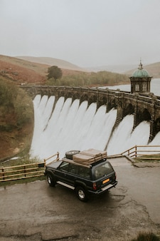 Car parked to a hydroelectric power generating dam