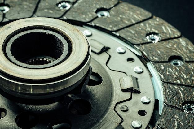 Car parts. break disc on black, close up