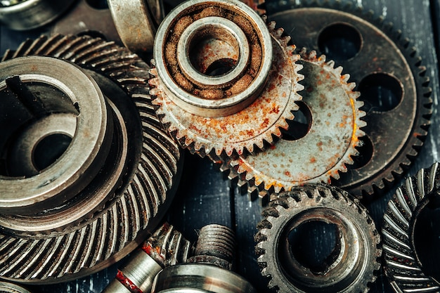 Car parts gears and bearings on wooden background