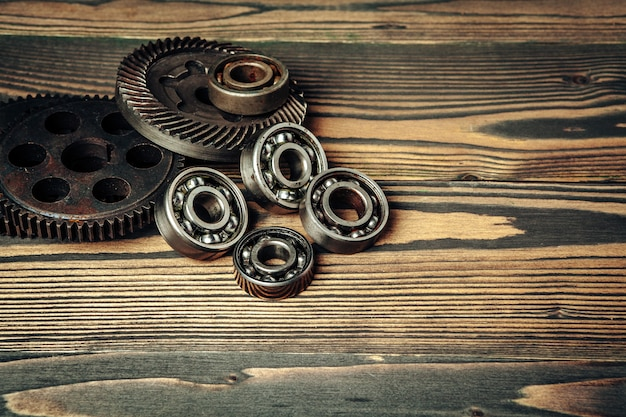 Car parts gears and bearings on wooden