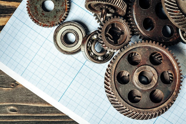 Car parts on graph paper for car engineering