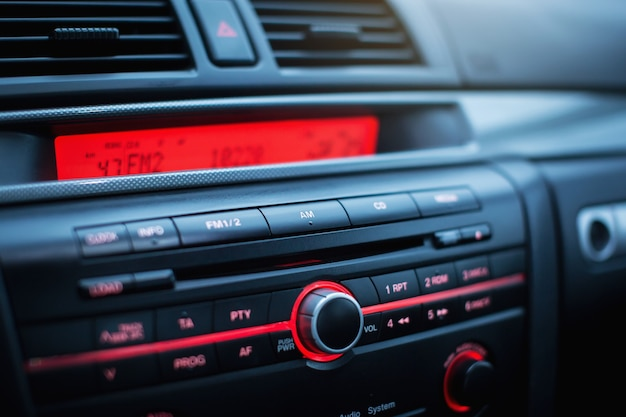 Car radio and air conditioner system button on dashboard in modern car panel