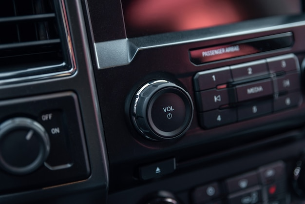 Car radio front volume close-up. modern car audio system. car radio controls.