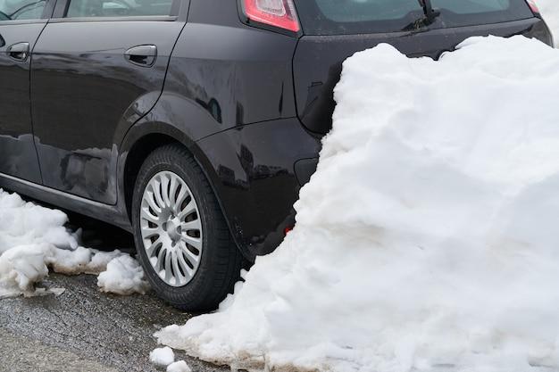 Car rear detail locked by snow heap