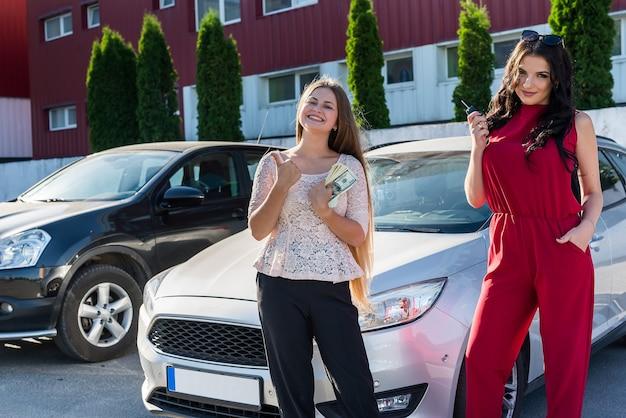 'car rent' deal between two beautiful women