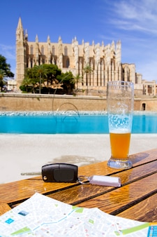 Car rental keys on the table with city tourist map in palma